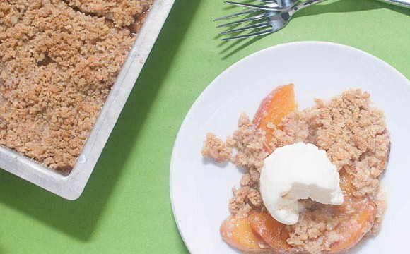 Peach Crisp served warm with some vanilla ice cream. Yummy! #GlutenFreeBaking #DessertRecipes #peaches